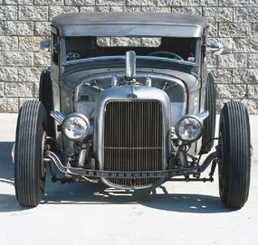 Jimmy left his '34 pickup unpainted, believing that the bare metal is more attractive than any paint color.