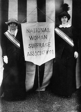 Katharine McCormick and Mrs. Charles Parker hold a banner for the National Woman Suffage Association, April 22, 1913.