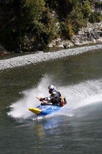 Shaun Baker pilots his jet kayak down a river.