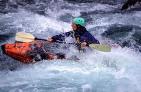 This white-water kayaker is getting his money's worth.