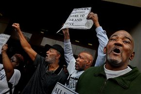 Former prisoners demonstrate at a rally for felon voting rights in Baltimore, Maryland. The state changed its law so that felons got their voting rights back after serving their prison sentences instead of having to complete parole and probation as well.