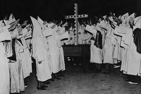 In the post-Reconstruction South, the Ku Klux Klan used violence and  killings to keep blacks from voting.