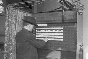A man votes in Chicago in 1906, using a lever. In the North at that time, officials sought to keep immigrants and ethnic and religious minorities from voting, often by changing registration dates or demanding they show original naturalization papers.