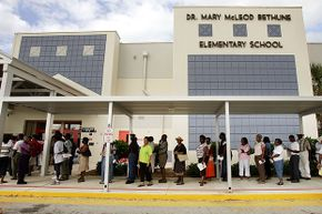"""Voters wait in line in Riviera Beach, Florida in 2004. Before the 2000 presidential election, state officials had """"ineligible"""" people deleted off the voter registration rolls — which disproportionately affected black voters."""