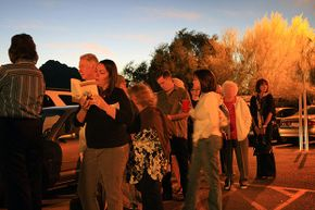 People line up at their polling place, St. Stephen's Byzantine Catholic Church, Arizona. The state's main county has steadily reduced the numbers of polling places over the past three election cycles, leading to accusations of voter suppression.