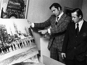In 1974, two guardsmen examine a photo taken shortly before they fired into the crowd at Kent State.
