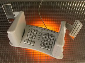 The SafeType keyboard places the two halves of the keyboard perpendicular to the desk surface.