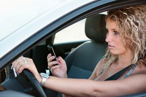 Among the rules to set in your teen-parent driving agreement is no texting or talking on the phone while driving.