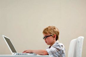 At what age you should buy a child his own laptop and how many bells and whistles does a young boy really need?
