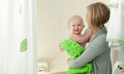 Mother and baby in bathroom