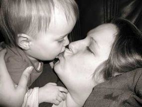 Research suggests that mothers kiss their babies because of the way prehistoric mothers fed their children.