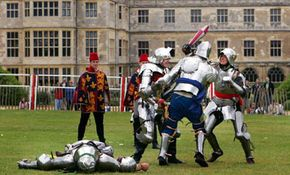 Knights club each other in the last-man-standing foot combat challenge (melee) during a tournament in England in 2005.