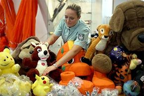 A employee displays counterfeit soft toys at the German Customs Investigation Bureau (ZKA) in Cologne, Germany, in 2013.