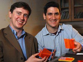 MIT Associate Professor Marc Baldo (left) and postdoctoral student Shalom Goffri show off some organic solar concentrators.
