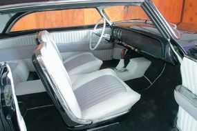 When restored, the interior of La Jolla was redone in white and light lavender upholstery that complemented the car's new dark purple exterior.