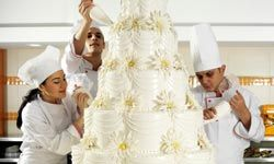 Some wedding cakes require a team and several days just to decorate.