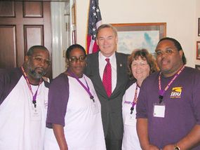 Labor unions are an important constituency for elected officials. Here Congressman Dennis Moore (D-Kansas) meets with members of the Service Employees International Union.