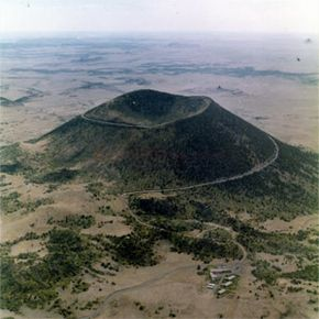 Capulin Volcano National Monument, New Mexico. Capulin Mountain, a huge cinder cone that erupted thousands of years ago, rises 1,000 feet (305 meters) above its base.