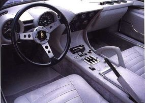 A side-mounted engine allowed the Miura's cabin to be more spacious, though the sheer size of the engine made the interior a hot, noisy place.