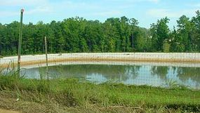 A leachate collection pond is designed to catch the contaminants that can get into water that goes through the trash in a landfill.