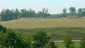 Grass and other plants cover the municipal solid waste landfill.