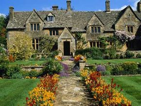 Traditional Cotswold house and gardens, Gloucestershire, England. See more pictures of famous gardens.