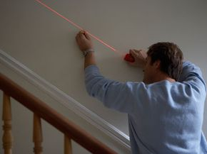 A laser level will make hanging pictures a cinch. See how a home is built by viewing these home construction pictures.