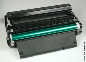 In a lot of printers, the toner hopper, developer and drum assembly are combined in one replaceable cartridge.