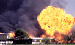Grainy footage from April 1993 shows the Branch Davidian compound exploding into flames.