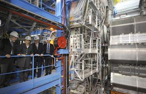 Angela Merkel, Chancellor of Germany, tours the LHC with a group of engineers.