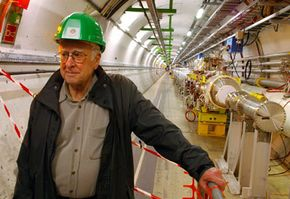 Peter Higgs, the man for whom the Higgs boson particle was named, tours the LHC.