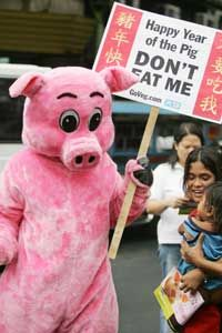 You don't need thousands of people for a protest -- one man in a pig costume can often grab plenty of media attention on his own. See more protesting pictures.