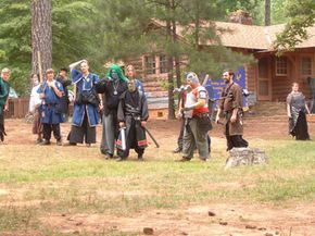 Most games take place at outdoor locations with lodges or other areas for players to congregate, prepare food and eat.