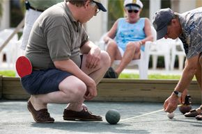Playing bocce comes with the added bonus of being able to use your fake Italian accent. (Skip this step if you're actually Italian or playing with Italians.)