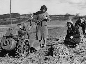 """""""Back in my day, our tillers were large an unwieldy. And we worked in dresses and liked it!"""""""