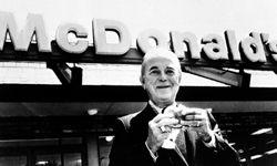 Ray Kroc enjoying a hamburger