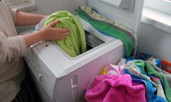 Sort heavy fabrics like towels from lighter fabrics so they don't get damaged -- and so they dry in about the same amount of time.