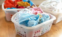 Sorting laundry really shouldn't be that time-consuming. If you have a few strategically labeled hampers, the job should be done as you toss dirty clothes into them.