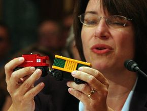 U.S. Sen. Amy Klobuchar, D-Minn., holds a toy train with lead paint as she testifies before Congress in 2007. U.S. lawmakers grilled the top executives of leading American toy companies following product safety scares tied to millions of Chinese-made toys.