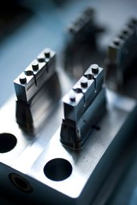 The injection-molding process uses large, heavy molds that are manufactured in Germany.