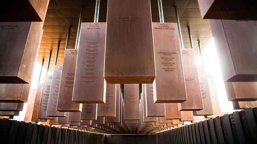 Steel columns with the names of victims of lynchings