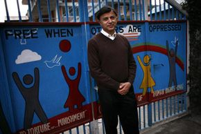 Dr. Bhogendra Sharma, president ofthe Centre for Victims of Torture,stands outside the group's office in Katmandu, Nepal, in 2006. Groups like this one believe that freedom from torture is a human right.