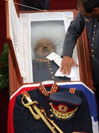 Chilean president Gen. Augusto Pinochet, shown in state in Santiago in 2006, was tried in a British international court for genocide and torture in 2000. He was acquitted.
