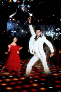 """Don't look up, Karen Lynn Gorney. That finger to the sky is just one of John Travolta's definitive moves from the 1977 film """"Saturday Night Fever."""" See more pictures of the history of fashion."""
