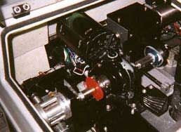 A red pattern is used in the edger to determine the final shape of the lens.