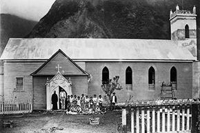 Father Damien stands with patients outside his church on Molokai Island. He served the island's leprosarium, eventually contracting the disease himself.