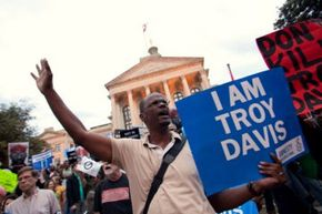 Michael Henry and other protesters for Troy Davis gather on the steps of the Georgia Capitol building on Sept. 20, 2011, in Atlanta, Ga. Davis was executed by lethal injection on Sept. 21.