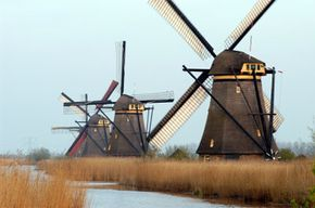 The windmills of Holland pump water from behind the dikes and back out to sea to keep the land dry.