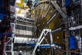 A maintenance worker inspects the Large Hadron Collider (LHC) tunnel in the CERN (European Organization For Nuclear Research) research center on Nov. 19, 2013, in Geneva, Switzerland.