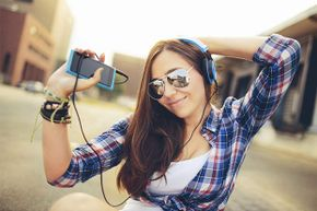 Keep on jamming -- you're not a lightning target with your headphones on.